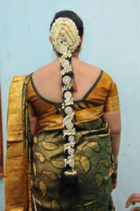 Layered rings of flowers for long silky hair 199x300 - Most beautiful South Indian wedding hairstyles for Long Hair