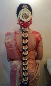 Long bridal braid with flower mandala 179x300 - Most beautiful South Indian wedding hairstyles for Long Hair