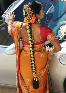 Maharani bridal style with white and orange hair braid 213x300 - Most beautiful South Indian wedding hairstyles for Long Hair