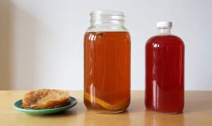 kombucha tea on table 300x178 - Wonderful Health Benefits of Kombucha and Probiotics