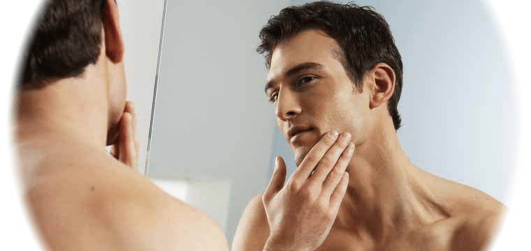 man shaving - How to treat bumps in men after shaving