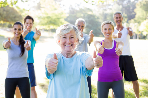 happy athletic group with thumbs up 13339 106460 - Aerobic cuts down excess cardiac adiposity