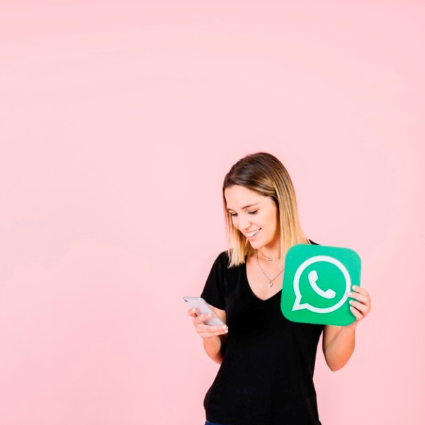 happy woman with whatsapp icon using cellphone 23 2147849413 - WhatsApp is good for your mental health, says a study