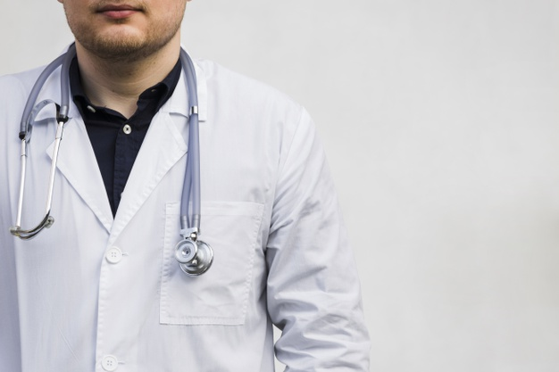 male doctor with stethoscope around his neck against white backdrop 23 2148129603 - How calcium in coronary arteries can predict future heart health